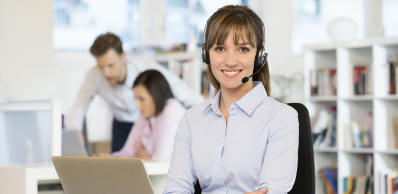 Business woman pretty smiling desk call phone skype